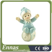 polyresin blue baby figure on feeder for birthday gift
