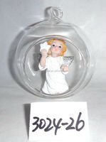 clear glass bauble with resin angel inside