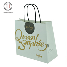 China manufacture wholesale Eco-friendly disposable large size kraft paper shopping bag for garment shoes with twsit handles