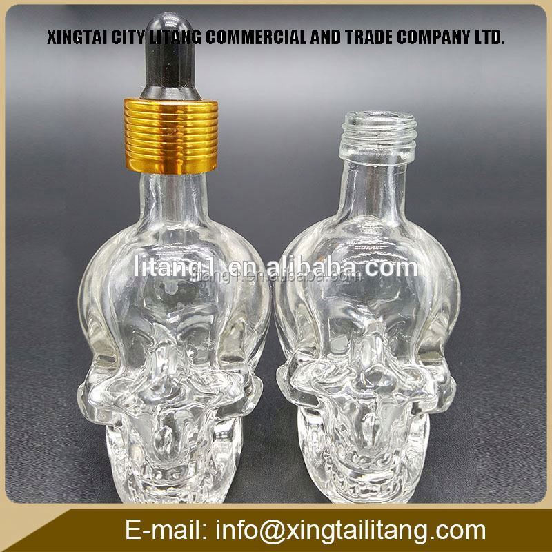 Christmas gift 15ml 30ml mini graceful skull shape perfume/e liquid glass bottle with child resistant lid and glass pipette