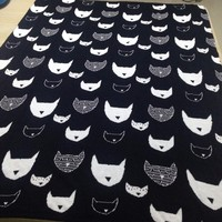 quirky cats knitted cotton blanket