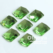 Factory hot sale high reflection peridot cosmic shape flat back glass sew on rhinestones for dresses decorations
