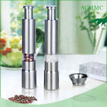 Portable mini thumb operated salt and pepper mill