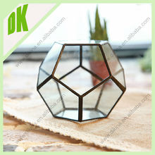 glass terrarium is hand painted, no all the terrarium are exactly the same . open geometric wine glass display box