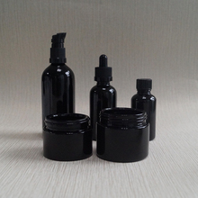 dark violet glass essential oil lotion cosmetic bottle and jar