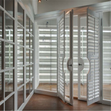 classice white timber louvre french window shutters interior