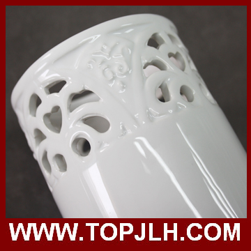 White ceramic flower vase with pierced style