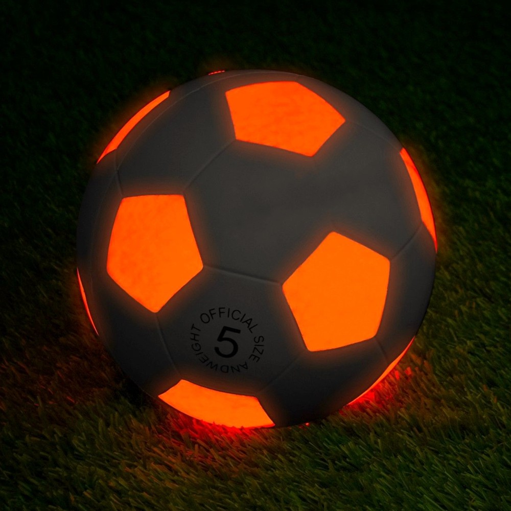 Rubber LED soccer ball glowing in the dark