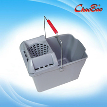 Pail and mop strainer combination