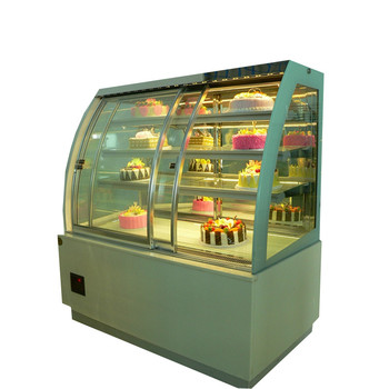 Single curve refrigerated cake cooler with front sliding door