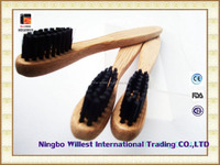 Family toothbrush with long thin bamboo handle and black soft bristle