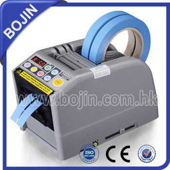 machine for strapping tape dispenser