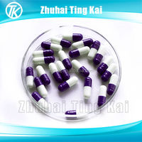 White and blue empty pill capsules