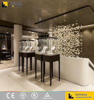 RJP0220 Modern Jewelry Display Tower Glass Showcase for Showroom Design