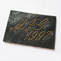 Garment Leather Patch with Metal Stud Design