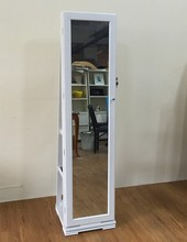 Floor standing swivel mirror jewelry cabinet