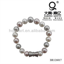 Round seashell MOP bracelet with horn clasp