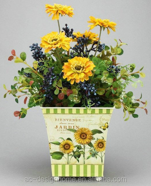 GOLDEN YELLOW MARIGOLD & BARRY ARRANGEMENT ON SQUARE IRON PLANTER
