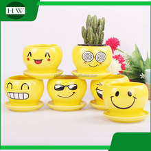wholesale cheap mini yellow round cup shape handwork decoration smiling face cement garden flower pot