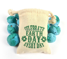 Plantable <strong>paper</strong> wildflower seed ball favors in muslin drawstring bags