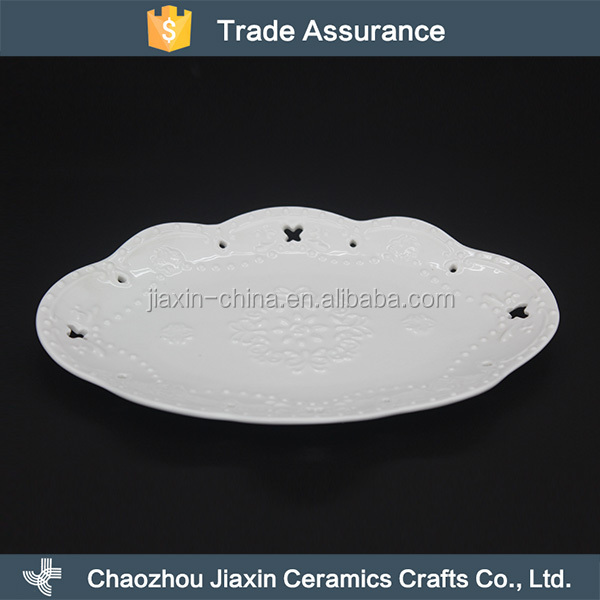 Classy elegant flower embossed white ceramic dish for napkin