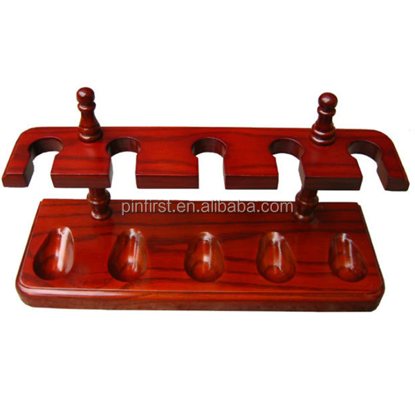 Red wooden smoking pipes holder