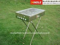 Charcoal BBQ grill made of stainless steel with folding stand