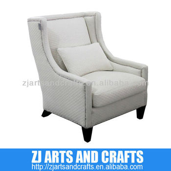 0474 arm sofa (Quilted natural linen arm chairr. With silver studs around arms and base with wenge finished legs.)