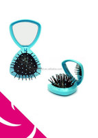 TRAVEL SIZE TRIANGULAR FOLDABLE HAIR BRUSH WITH POP UP PINS AND MIRROR