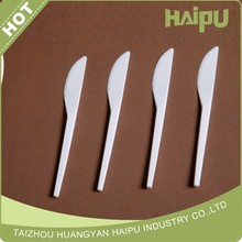 disposable dinnerware of white plastic knife