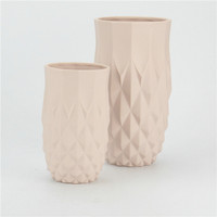 Table used light pink color differing sizes large tall ceramic wedding vases