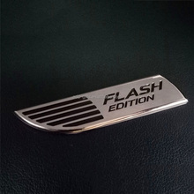 silver and black flash edition metal lapel pin with gummed paper backing