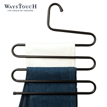 A multi-functional metal hanger for the use of a bathroom.