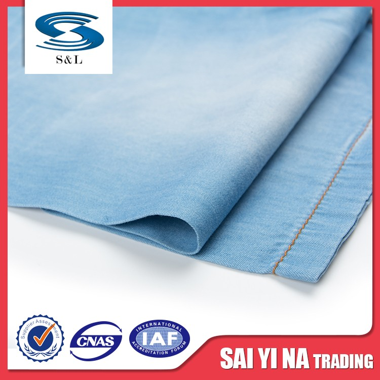 Stock lot textiles cotton denim fabric for clothing ang garment