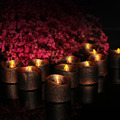 Romantic black base with yellow flickering batteries operated mini candle tea lights
