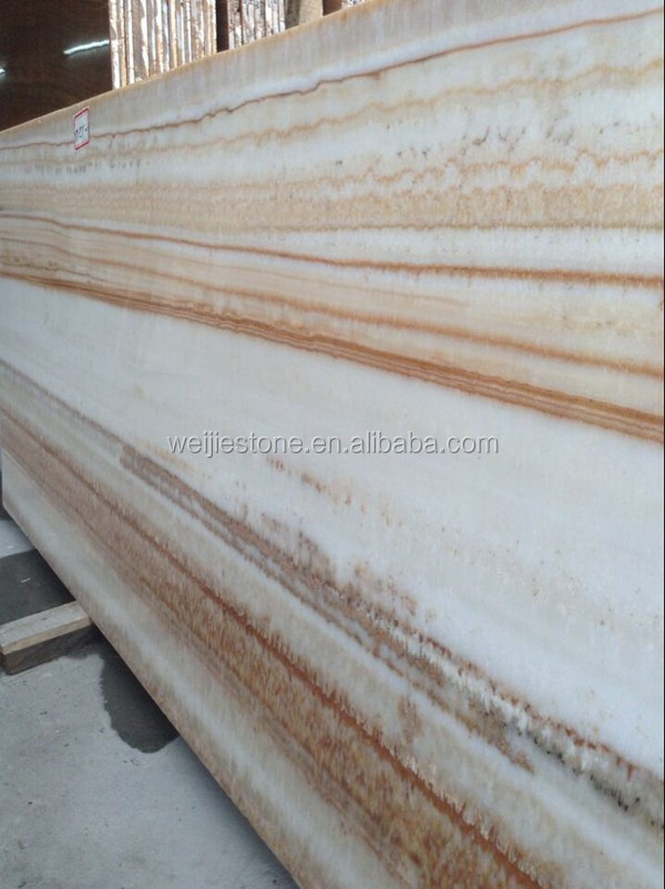 White Onyx marble with golden yellow wooden veins