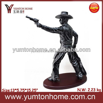 Resin West cowboy hero figurine with a gun