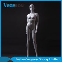 glossy female mannequin with sculpture hair