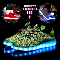 casual running shoes with charging LED light in the sole and flyknit upper