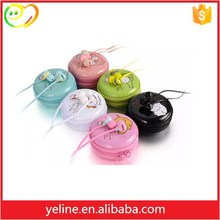 Microphone style earphone with storage box for laptop