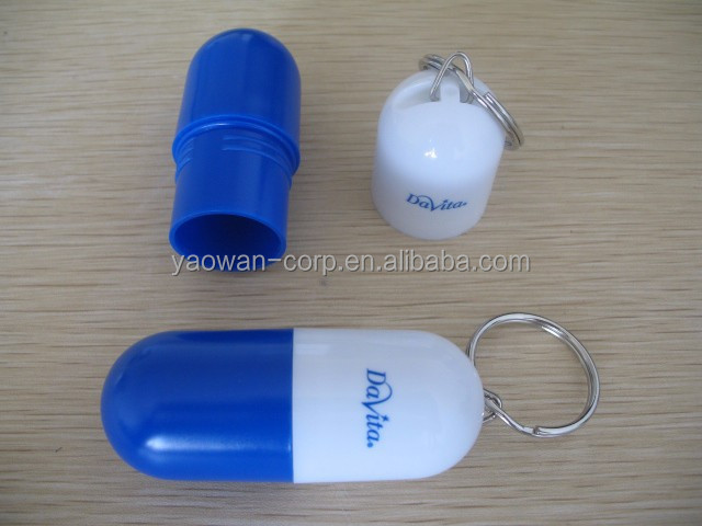 Plastic one piece capsule shape pill storage box/case with keychain