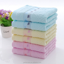 Cheapest towel in China market 100% cotton dobby plain dyed dobby face towel