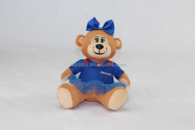 plush bear monkey type with a blue bowknot