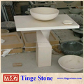 Pedestal base polished granite sink above countertop
