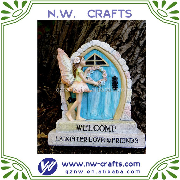 miniature fairy village door with fairy attached
