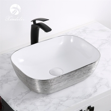 XDL-D1302H131 Nice price electroplate silver white ceramic wash elegance art washing basin sink bathroom