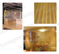 Decorative room partition metal coil drapery
