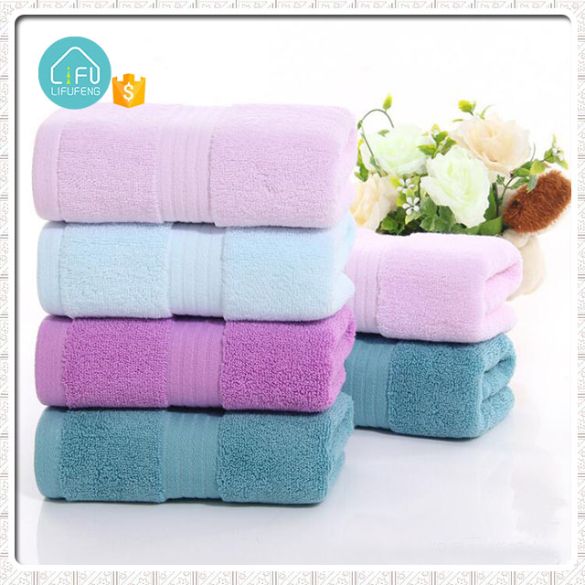 Wholesale super cheap 100% cotton fabric plain dyed face towel for hotel