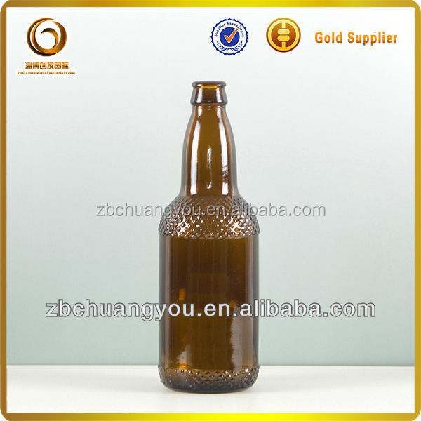 500ml dark amber open glass beer bottle with fridge magnet