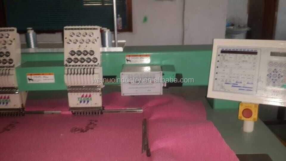 original Tajima TMFD-910 embroidery machine, barudan